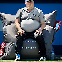 The Netherlands, Rosmalen, 16-06-2010.<br /> Tennis, UNICEF Open.<br /> The linesmen of the UNICEF Open are sitting in a Fatboy during the game like this linesman who is concentrating on the match between the dutch player Igor Sijsling versus Sergly Stakhovsky from the Ukrain.<br /> Photo : Klaas Jan van der Weij