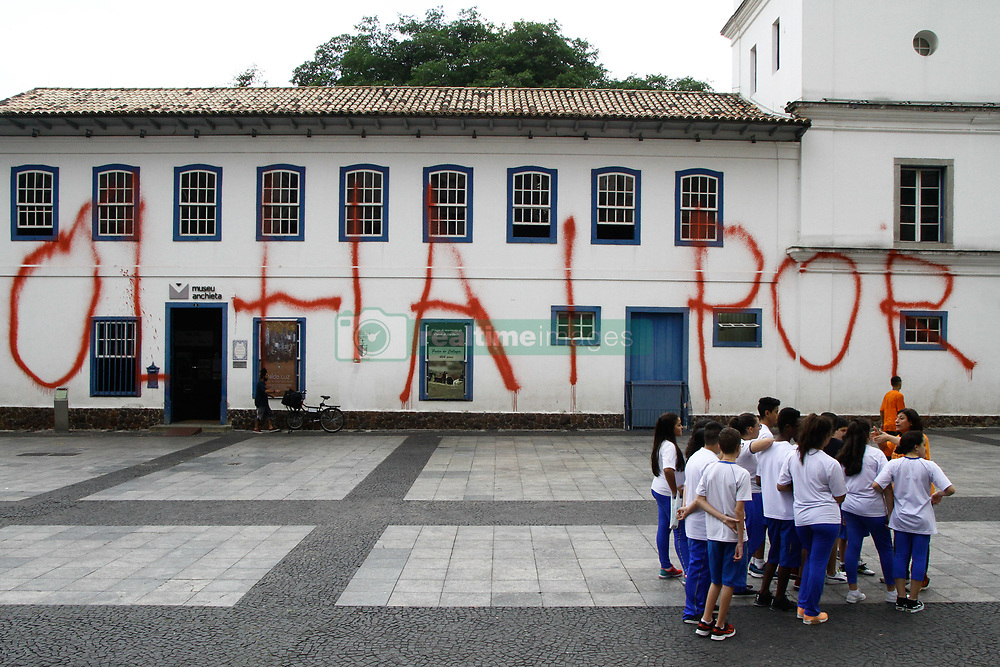 April 12, 2018 - Sao Paulo, Brazil - Graffitti or Pichacao, as it is called in Sao Paulo, with the phrase 'Olha por nos' was made as a protest in Pateo do Collegio, in the center of the city of Sao Paulo, Brazil, on 12 April 2018. The Pateo do Collegio is the starting point for the birth of the city of Sao Paulo. The place, at the top of a hill between the Tamanduateí and Anhangabaú rivers, was chosen to begin the catechization of the Indians. The maintenance of the complex is the responsibility of the Company of Jesus, an entity that belongs to the Catholic Church. The city council has promised to collaborate with the cleaning of the walls, but this can only be done after architects analyze how the process will be, not to put anything at risk, since the building is a historical patrimony. (Credit Image: © Fotorua/NurPhoto via ZUMA Press)