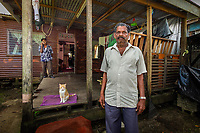 Wailea Settlment, Near Suva, Fiji | 2011<br /> Sambhu Lal, 69, worked for thirty-three years at the Labasa sugar mill while his family cut sugar cane. Their land lease expired in 2004 and was not renewed, forcing them to move to the outskirts of Suva, where his son now works in a sawmill. He transported his house by truck and boat from Labasa and reassembled it on leased land in a squatter settlement popular with displaced cane farmers.