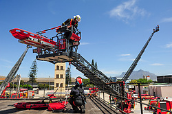 South Africa - Cape Town - 15 October 2020 - The City of Cape Town's Fire and Rescue Service displayed the new Rosenbauer Metz Turntable Ladder L56 at the Epping Training Academy. The new Rosenbauer Metz Turntable Ladder L56, with an aerial reach of approximately 56 meters, is a first for Africa. These specialised vehicles are the latest addition to the City's Fire and Rescue fleet. The hydraulic rescue platform vehicles are unique as up to six people can be lowered in a rescue cage from a building. Alderman JP Smith, Mayoral Committee Member for Safety and Security as well as the Chief Fire Officer, Ian Schnetler, was in attendance where the capabilities of the vehicles were displayed. Picture: Henk Kruger/African News Agency(ANA)