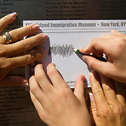 Visitors to the Ellis Island Immigration Museum where exhibits and engraved names of immigrants provide perspective on a nation built on immigrants. Please contact Todd Bigelow directly with your licensing requests.