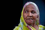 A 1984 gas-survivor is standing in front of her home in one of the nineteen water-affected colonies around the abandoned Union Carbide (now DOW Chemical) industrial complex in Bhopal, Madhya Pradesh, India.