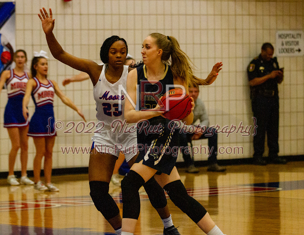 Moore's Aaliyah Moore stands up to Southmoore's Erin Bean as she goes to pass the ball during their game on Tuesday, December 18, 2018 at Moore High School.
