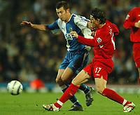 Photo: Back Page Images. 30/10/2004.<br /> Barclays Premiership. Blackburn Rovers v Liverpool. Ewood Park.<br /> Josemi tackles goalscorer Brett Emerton