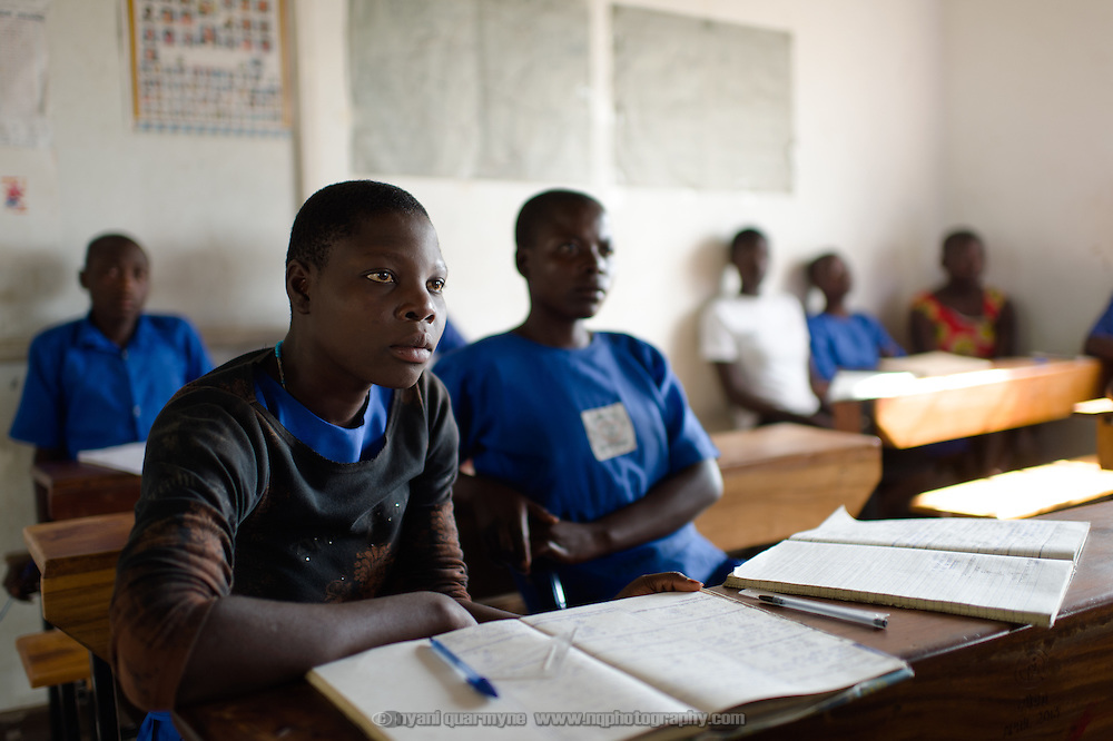 A student listening intently during a presentation on Menstrual Hygiene Management at Agwait Primary School near Tororo in Eastern Uganda on 1 August 2014.