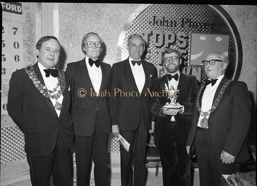 John Player Tops of the Town Final..1980-06-01.1st June 1980.01-06-1980.06-01-80..Photographed at Gaiety Theatre, Dublin...Irish Distillers Variety Group emerge as winner in the John Player Tops of the Town Final. They beat Waterford Banks and Finance by two marks. ..From Left:..Alderman Stephen Rogers, Mayor of Waterford...Bobby Cooke, Group leader of the Irish Distillers Variety Group...Frank O'Reilly, Chairman of John Player, who presented the National Final Trophy...Far Right: Alderman William Cummiskey, Lord Mayor of Dublin with a hand on the prize.