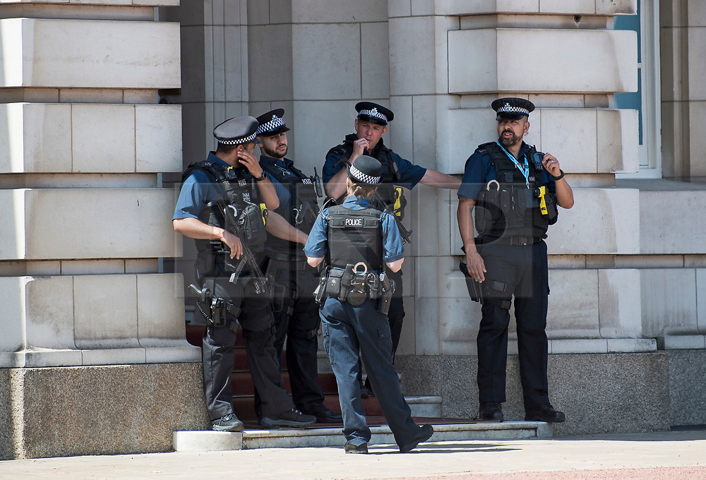 © Licensed to London News Pictures. 12/06/2021. London, UK. Police officers stand in the shade to shelter form the mid day sun, outside Buckingham Palace in central London on another hot summer's day. This weekend is expected to be the hottest of the year so far. Photo credit: Ben Cawthra/LNP