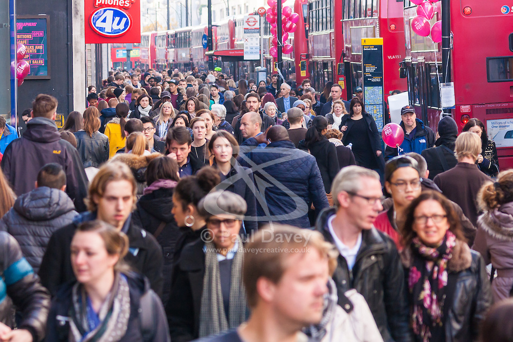 th 2014. Tens of thousands of shoppers flood central London as  Black Friday discounts and most people's pay days kick off the Christmas shopping season in earnest. PICTURED: Thousands of people make their way along Oxford Street.
