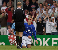Photo: Daniel Hambury.<br /> Fulham v Everton. The Barclays Premiership.<br /> 27/08/2005.<br /> Everton's Phil Neville knows whats coming as referee Mike Riley prepares to show the red card.