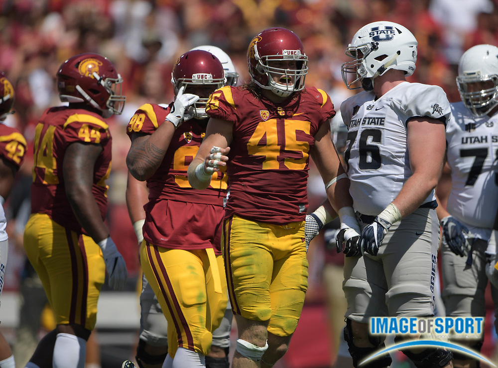 Sep 10, 2016; Los Angeles, CA, USA; USC Trojans defensive end Porter Gustin (45) celebrates during a NCAA football game against the Utah State Aggies at Los Angeles Memorial Coliseum. USC defeated Utah State 45-7.