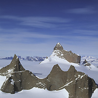 Antarctica, Queen Maud Land.  Fenris Mountains. Unnamed peaks in front of  2931m Ulvetanna and Fenris Tongue Glacier. Holtedahl Mountains far background.