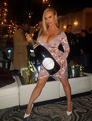 """Coco Austin releases a photo on Twitter with the following caption: """"""""This bottle is almost as big as me!!<br /> <br /> Spent time with my lovely friends at Grand opening of Hudson and Co"""""""". Photo Credit: Twitter *** No USA Distribution *** For Editorial Use Only *** Not to be Published in Books or Photo Books ***  Please note: Fees charged by the agency are for the agency's services only, and do not, nor are they intended to, convey to the user any ownership of Copyright or License in the material. The agency does not claim any ownership including but not limited to Copyright or License in the attached material. By publishing this material you expressly agree to indemnify and to hold the agency and its directors, shareholders and employees harmless from any loss, claims, damages, demands, expenses (including legal fees), or any causes of action or allegation against the agency arising out of or connected in any way with publication of the material."""