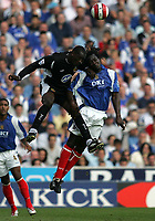 Photo: Lee Earle.<br /> Portsmouth v Wigan Athletic. The Barclays Premiership. 09/09/2006. Wigan's Emile Heskey (L) clashes with Linvoy Primus.