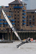 Ben Ainslie sails under Tower Bridge to celebate his Olympic gold medal, the Thames, London 5 September 2008.  Guy Bell 07771 786236