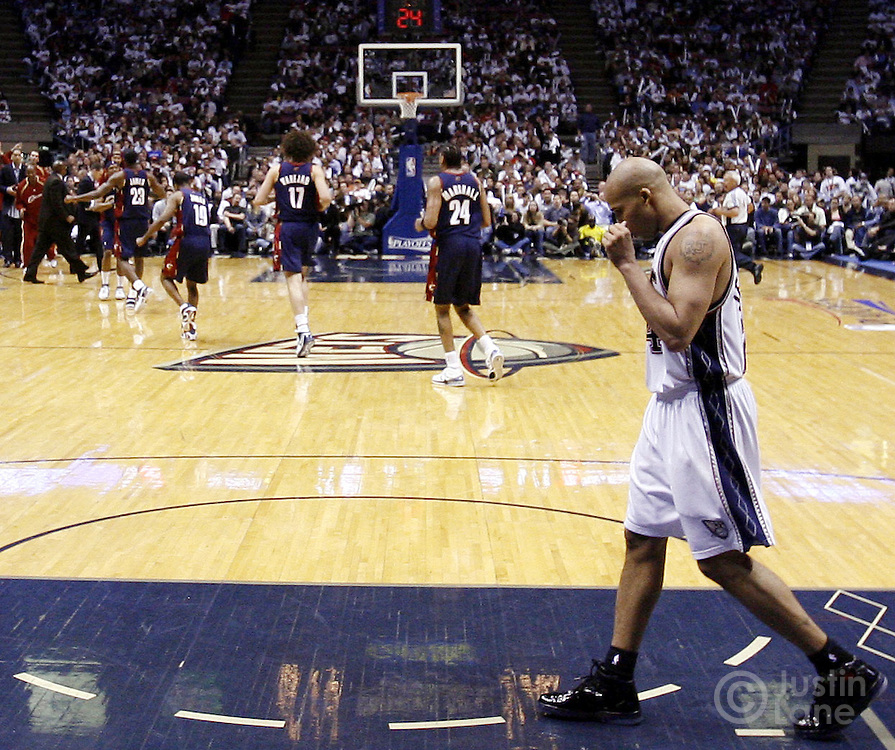 The Nets' Richard Jefferson (R) walks along the court as the Cavaliers' (background left) celebrate near the end of the second half of game 6 of the Eastern Conference semifinals between the Cleveland Cavaliers and the New Jersey Nets at Continental Airlines Arena in East Rutherford, New Jersey on 18 May 2007. The Cavaliers' defeated the Nets 88-72 and as a result won their series, 4-1.