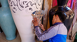 A man stencilling a design onto a large vase in the medina in Marrakech, Morocco, North Africa<br /> <br /> <br /> <br /> (c) Andrew Wilson | Edinburgh Elite media