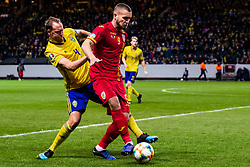 March 23, 2019 - Stockholm, SWEDEN - 190323 Andreas Granqvist of Sweden and George Puscas of Romania during the UEFA Euro Qualifier football match between Sweden and Romania on March 23, 2019 in Stockholm. (Credit Image: © Andreas L Eriksson/Bildbyran via ZUMA Press)