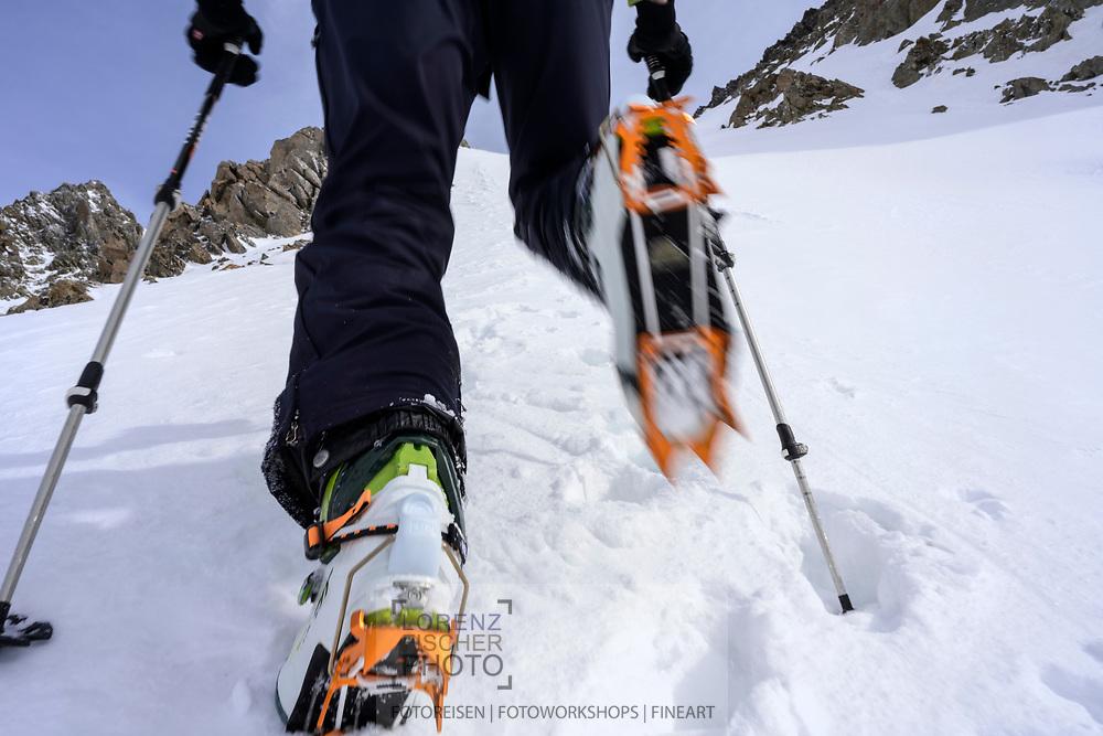 Climbing up with crampons on the steepest part an a ski tour from the Meiental on mount Zwächten with a descent to the Erstfeld valley, Uri, Switzerland<br /> <br /> Skitour vom Meiental auf den Zwächten mit Abfahrt ins Erstfelder Tal, Uri, Schweiz