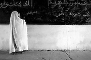 Girl writing on black board at the Mame Diarra Bousso koranic school in the village of Porokhane, Senegal, on Monday June 18, 2007.