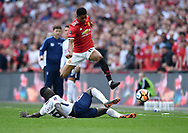 Marcus Rashford of Manchester United is challenged by Davinson Sanchez of Tottenham Hotspur during the FA cup semi-final match at Wembley Stadium, London. Picture date 21st April, 2018. Picture credit should read: Robin Parker/Sportimage