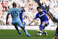 Cesc Fabregas of Chelsea ® looks to go past Ferdandinho of Man city. Barclays premier league match, Manchester city v Chelsea at the Etihad stadium in Manchester,Lancs on Sunday 21st Sept 2014<br /> pic by Andrew Orchard, Andrew Orchard sports photography.
