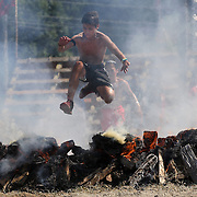 Competitors in action at the fire jump obstacle during the Reebok Spartan Race. Mohegan Sun, Uncasville, Connecticut, USA. 28th June 2014. Photo Tim Clayton