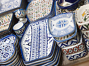 Artisanal handmade dishes and cups for sale at a shop in the medina in Fes, Morocco