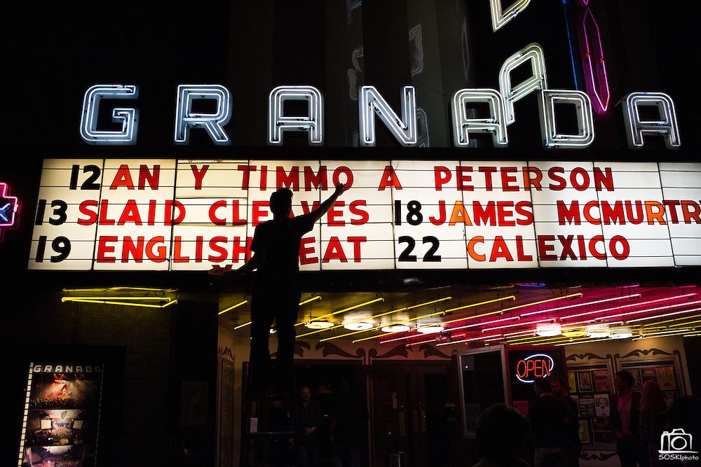 Granada Serenity staff member Christian Rios changes the letters on the theater sign as Lucky Peterson headlines at the Granada Theater in Dallas, Texas, on January 11, 2013.  (Stan Olszewski/The Dallas Morning News)