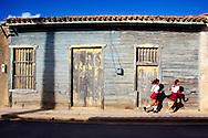 House and running school girls in Gibara, Holguin, Cuba.
