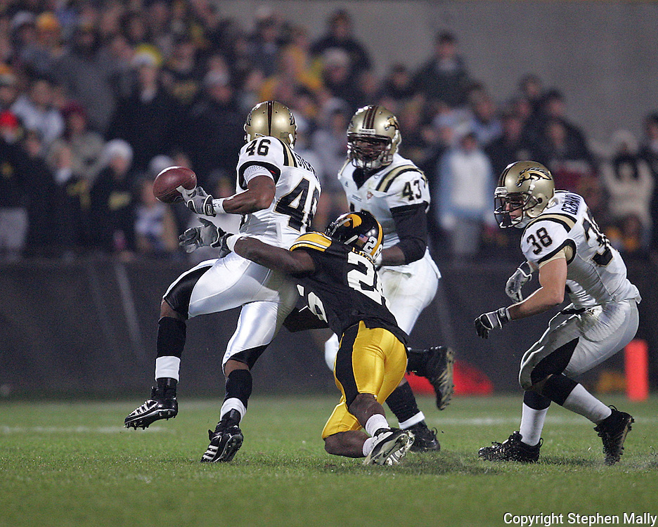 17 NOVEMBER 2007: Iowa wide receiver Paul Chaney (26) knocks the ball loose after Western Michigan safety Desman Stephen (46) intercepts a pass in Western Michigan's 28-19 win over Iowa at Kinnick Stadium in Iowa City, Iowa on November 17, 2007.