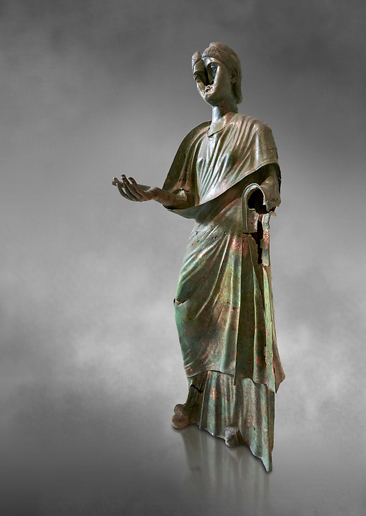 Bronze statue of Roman empress Julia Aquilia Severa found at Sparta. circa 221-222 AD.  Athens National Archaeological Museum, Cat No X23321. Against grey.<br /> <br /> The women in the Bronze statue wears a Chiton and himation and would have had a crwon on her head. The hair style is typical of the Severan dynisty. Julia Aquilia was the last wife of emperor Elagobalus (218-222 AD) and the damage to the statue is due to a building collapsing on it after a fire circa 221-222 AD .<br /> <br /> If you prefer to buy from our ALAMY STOCK LIBRARY page at https://www.alamy.com/portfolio/paul-williams-funkystock/greco-roman-sculptures.html . Type -    Athens    - into LOWER SEARCH WITHIN GALLERY box - Refine search by adding a subject, place, background colour, etc.<br /> <br /> Visit our ROMAN WORLD PHOTO COLLECTIONS for more photos to download or buy as wall art prints https://funkystock.photoshelter.com/gallery-collection/The-Romans-Art-Artefacts-Antiquities-Historic-Sites-Pictures-Images/C0000r2uLJJo9_s0