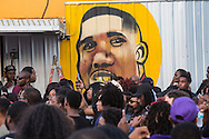 People at a vigil for Alton Sterling at the Triple S Food Mart,  in front of a mural by  Jo Hines spray of Alton Sterling in Baton Rouge, La., Wednesday, July 6, 2016Wednesday, July 6, 2016.