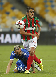 August 24, 2017 - Mykola Morozyuk (L) of Dynamo vies for the ball with Everton (R) of Maritimo  during the Europa League second play-off soccer match between FC Dynamo Kyiv and FC Maritimo, at the Olimpiyskyi stadium in Kyiv, Ukraine, August 24, 2017. (Credit Image: © Anatolii Stepanov via ZUMA Wire)