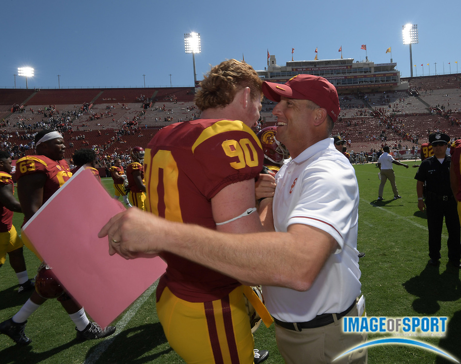 Sep 10, 2016; Los Angeles, CA, USA; USC Trojans head coach Clay Helton celebrates with defensive end Connor Murphy (90) after a NCAA football game against the Utah State Aggies at Los Angeles Memorial Coliseum. USC defeated Utah State 45-7.