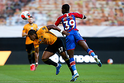 Tyrick Mitchell of Crystal Palace beats Adama Traore of Wolverhampton Wanderers to a header - Mandatory by-line: Robbie Stephenson/JMP - 20/07/2020 - FOOTBALL - Molineux - Wolverhampton, England - Wolverhampton Wanderers v Crystal Palace - Premier League