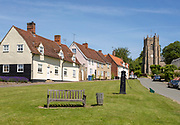 Pretty historic cottages and church in village of Monks Eleigh, Suffolk, England, UK