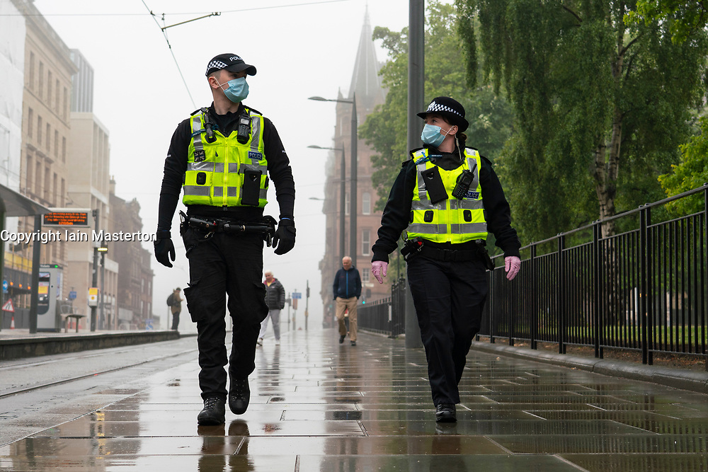 Edinburgh, Scotland, UK. 13 June 2020. Police patrol St Andrew Square on Saturday afternoon. A planned Black Lives Matter demonstration in the square seems to have attracted only a few peaceful protestors. The square is the site of the Melville Monument and statue of Henry Dundas, Protestors want the statue removed. Iain Masterton/Alamy Live News