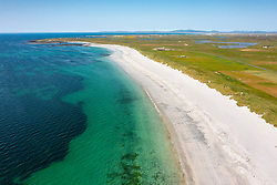 Aerial view from drone of white sands on beach on west coast of island of Benbecula, Outer Hebrides, Scotland, UK