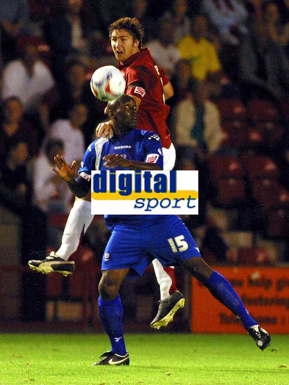 Photo: Dave Linney.<br />Walsall v Peterborough United. Coca Cola League 2. 12/09/2006.Walsall's Ian Roper(Top) beats Lloyd Opara<br />to the ball.