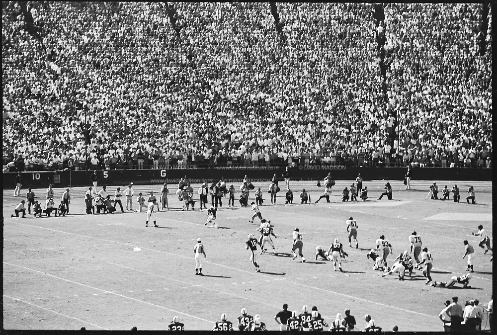 COLLEGE FOOTBALL:  Stanford vs USC (#4 ranking) on October 10, 1970 at Stanford Stadium in Palo Alto, California.  Stanford won by a final score of 24-14.  Randy Vataha #18 catches a pass from Jim Plunkett #16.  Photograph by David Madison / www.davidmadison.com.  R0067