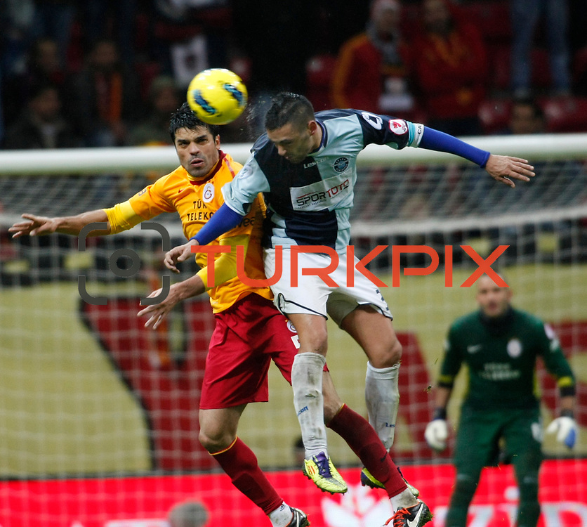 Galatasaray's Gokhan Zan (L) during their Turkey Cup matchday 3 soccer match Galatasaray between AdanaDemirspor at the Turk Telekom Arena at Aslantepe in Istanbul Turkey on Tuesday 10 January 2012. Photo by TURKPIX