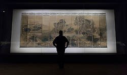 © Licensed to London News Pictures. 23/10/2013. London, UK. A member of Victoria and Albert Museum staff views 'The Palace of Nine Perfections' (1691) by Yuan Jiang at the press view for 'Masterpieces of Chinese Painting 700 - 1900' at the museum in London today (23/10/2013). The exhibition, running from the 26th of October 2013 to the 19th of January 2014, features some of the finest examples of Chinese painting created over a 1200 year period. Photo credit: Matt Cetti-Roberts/LNP