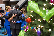 Retired Neurosurgeon and Republican presidential candidate Dr. Ben Carson poses for photos with nurses during a visit to the MUSC Children's Hospital December 22, 2015 in Charleston, South Carolina. Carson stopped by to listen to Christmas carols and greet the young patients.