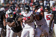 Oakland Raiders outside linebacker Bruce Irvin (51) stops the ball during a game against the Atlanta Falcons at Oakland Coliseum in Oakland, Calif., on September 18, 2016. (Stan Olszewski/Special to S.F. Examiner)
