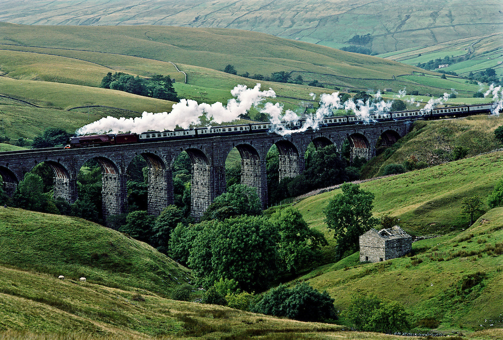 A train running through the landscape of Northern England.