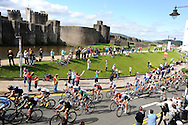 a general view as the competitors pass Caerphilly Castle. Tour of Britain cycle race 2011, action from stage 4, Welshpool to Caerphilly , South Wales on Wed 14th Sept 2011. Pic By  Andrew Orchard, Andrew Orchard sports photography,