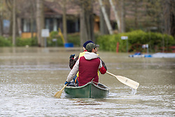 Two men paddle a canoe along a street surrounded by floodwaters in the town of Rigaud, Quebec, Canada., west of Montreal, Monday, May 8, 2017, following flooding in the region. Photo by Graham Hughes /The Canadian Press/ABACAPRESS.COM