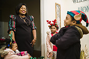 SELMA, AL – DECEMBER 11, 2019: Keshee Dozier-Smith, 34, gathers her four children at home before attending their annual Christmas program.<br /> <br /> Since joining Rural Health Medical Program as Chief Executive Officer in March 2016, Dozier-Smith has effectively moderned the 35-year-old floundering business – opening three new clinics, streamlining processes and reaching out to local companies to offer healthcare services for employees. In the wake of rising hospital closures that leave Alabama's poorest citizens disproportionately cut off from access to medical care, Dozier-Smith represents a renewed effort to bridge the rural gap by offering a quality, affordable healthcare option.