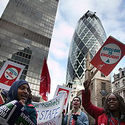Demonstrators from Tower Hamlet march through the City of London, London's financial district. Numerous trade unions in the public sector called for a day of strike and in that connection marched in London against the Government's pension cuts. Most schools in Scotland were shut and more than half of all schools in England were shut for the day . Many nurses, doctors and health workers went on strike in protests against the Government's austerity measures.