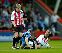 Photo: Richard Lane.<br />Cheltenham Town v Wycombe Wanderers. Coca Cola League 2. Play off Semi Final, 2nd Leg. 18/05/2006.<br />Wycombe's Rob Lee is brought down by John Finnigan.